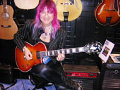 female guitarist Shredmistress Rynata at D'Aquisto at NAMM