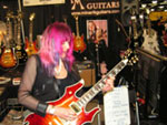 Shredmistress Rynata with Minarik Inferno guitar at Namm