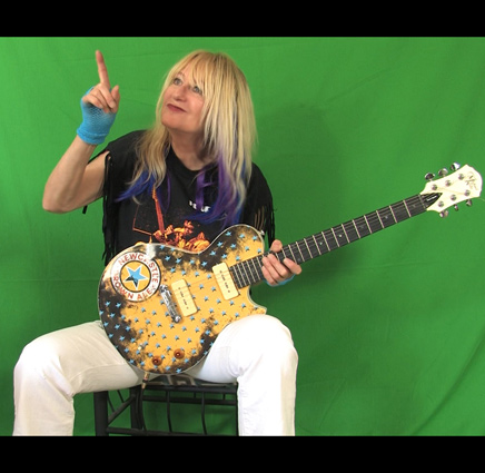 Shredmistress Rynata a Female Guitarist plays the Michael Kelly Guitar