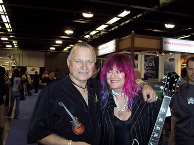 Dick Dale and Shredmistress Rynata jamming at the Minarik Guitar Booth.