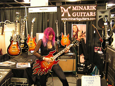 Shredmistress Rynata at Minarik Guitars | Namm Show | sunburst Inferno
